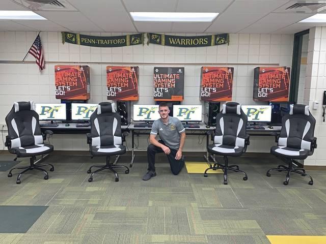 Teacher John Carlisle poses in Penn-Trafford High School's new esports lab.
