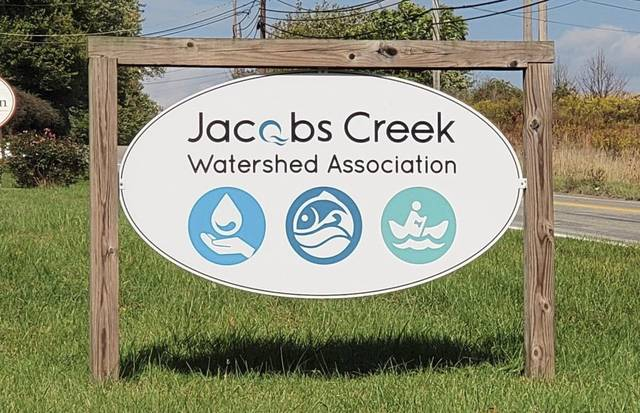A sign advertises the new office of Jacobs Creek Watershed Association, at the historic West Overton Village along Route 819 in East Huntingdon. The watershed group took up residence there in August 2020.