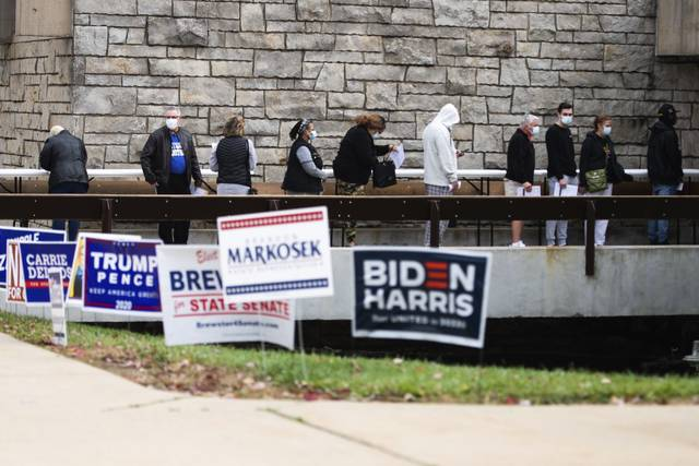 Voters wait in line to place ballots in an early voting drop box at the ski lodge Saturday<ins>,</ins><ins> Oct. 24, 2020</ins> at Boyce Park in Plum.