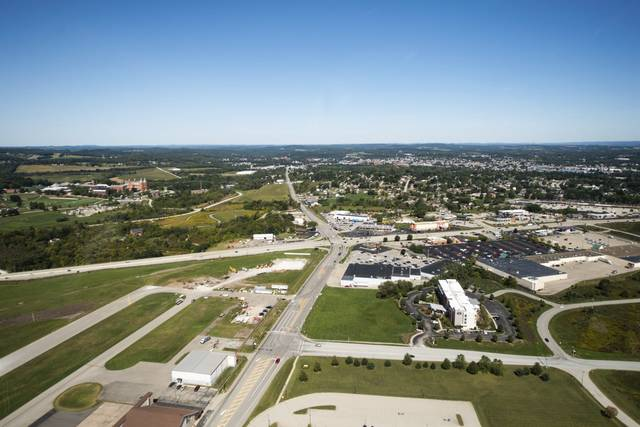 An aerial view on Sept. 21 over Arnold Palmer Regional Airport over Latrobe shows the intersection of Route 30 and Technology Drive, with SpringHill Suites hotel to the right.