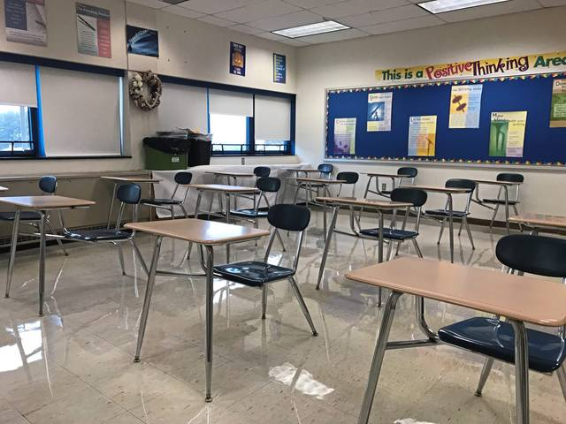 Desks are placed 6 feet apart in a classroom at Hempfield Area High School.