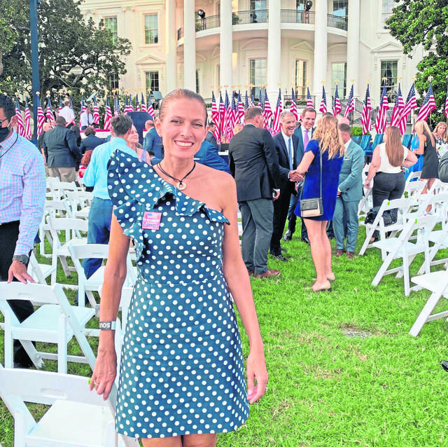 Leslie Rossi, the Unity woman who created the Trump House, stands outside the White House where she was an invited guest last August when President Donald Trump accepted the party's nomination to seek for re-election.