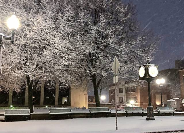 Snow falls on the Courthouse Square on Main Street in Greensburg on Feb. 7.