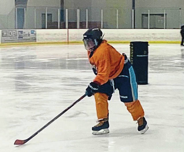 Adison Lemmon, 17, of Unity practices with the Pittsburgh Rhinos blind ice hockey team on Feb. 6at Center Ice Arena in Delmont. Her vision is impaired because of a condition that affects her irises.