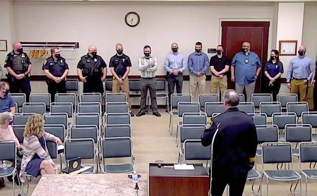 Murrysville Police Chief Tom Seefeld introduces members of the department at the Wednesday, April 7, 2021, Murrysville council meeting.