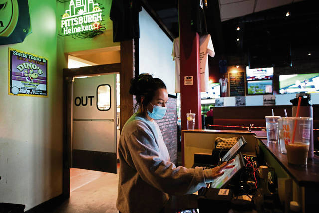 Justyne Howell takes orders short-staffed at Dino's Sports Lounge in Greensburg.