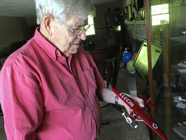 Latrobe native Bob Downs, 90, of Monroeville, shows a model of a Stinson Gullwing plane, similar to the ones used to pick up bags of airmail on the fly beginning in 1939 at the Latrobe Airport, now Arnold Palmer Regional Airport, in Unity.