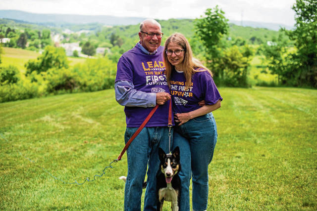 Don and Sara Belt at their home in Unity, along with Sara's therapy dog, Rayhab.