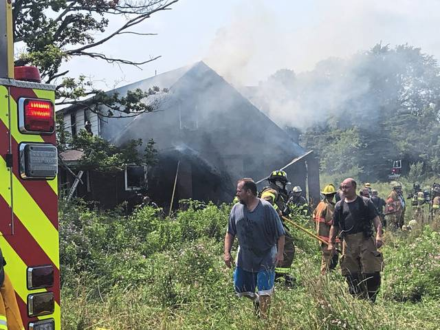 Nearly a dozen fire companies battled a vacant house fire near the intersection of First Street Extension and Drakulic Lane in Penn Township on Monday, July 5, 2021.
