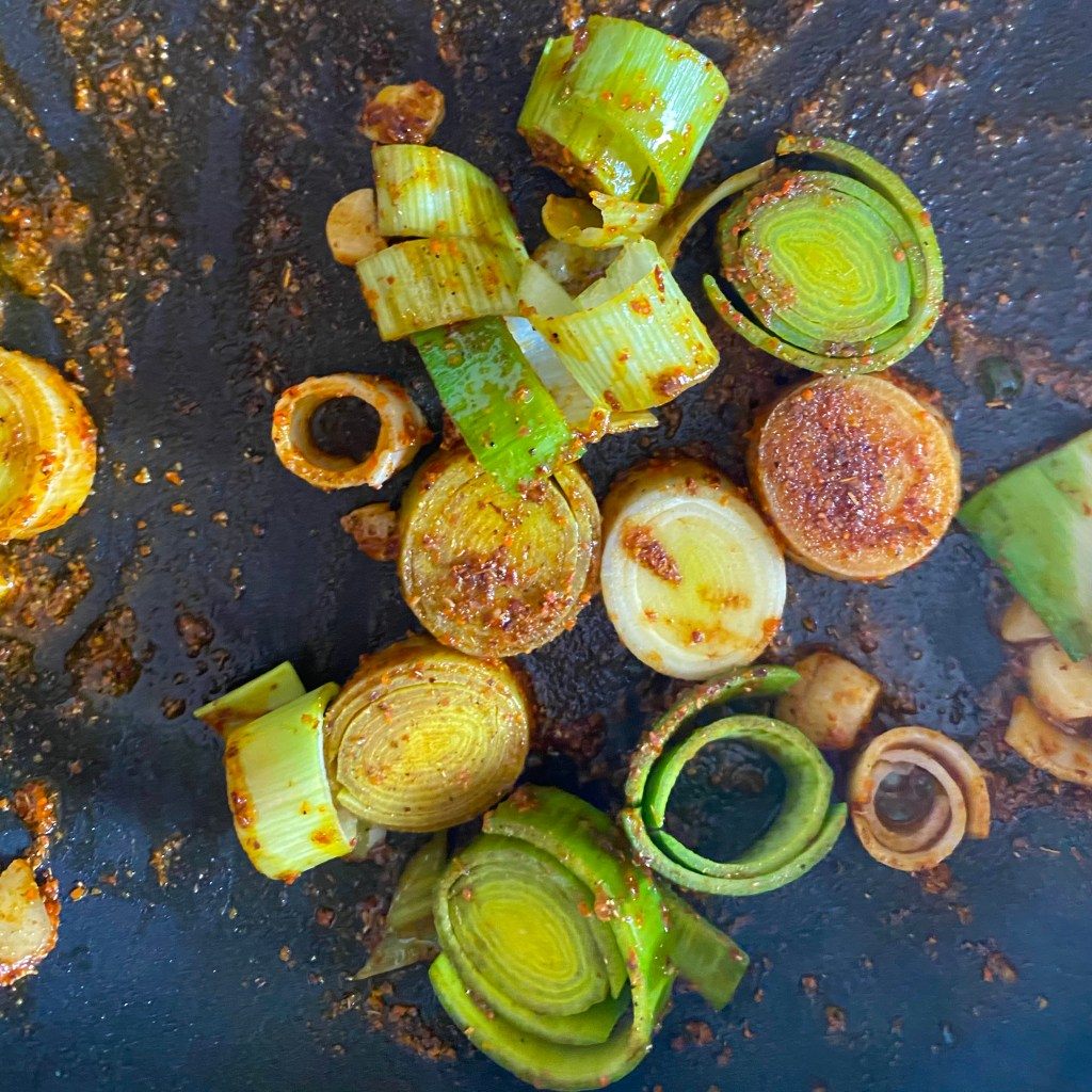 frying leek and spices in olive oil