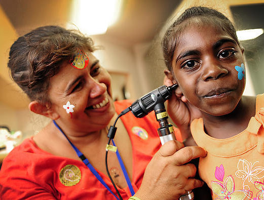 A supplied image of Sandy Nelson as she checks the ear of Kirsty Dumoo during the opening of the Wadeye Health Centre, 400km south west of Darwin, Tuesday, Nov. 9, 2010. The $7.6 million Commonwealth-funded clinic has been four years in the making and has been culturally designed to accommodate the individual private needs of men and women. (AAP Image/Clive Hyde, Northern Territory Government) NO ARCHIVING, EDITORIAL USE ONLY