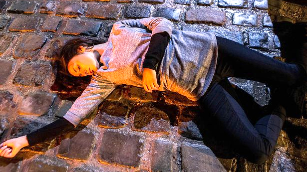 Corrie set tour visitors loved to recreate TIna lying dead on the cobbes. ©ITV