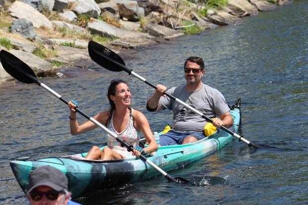 Sen. Diana DiZoglio shares a tandem kayak with Dougan Sherwood, president of the Greater Haverhill Chamber of Commerce.