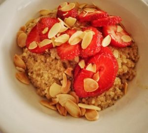 Quinoa Porridge with Sliced Strawberries & Chia Seeds