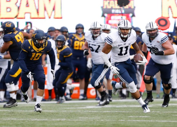 Nov 29, 2014; Berkeley, CA, USA; Brigham Young Cougars wide receiver Terenn Houk (11) carries the ball against the California Golden Bears during the third quarter at Memorial Stadium. The Brigham Young Cougars defeated the California Golden Bears 42-35. Mandatory Credit: Kelley L Cox-USA TODAY Sports