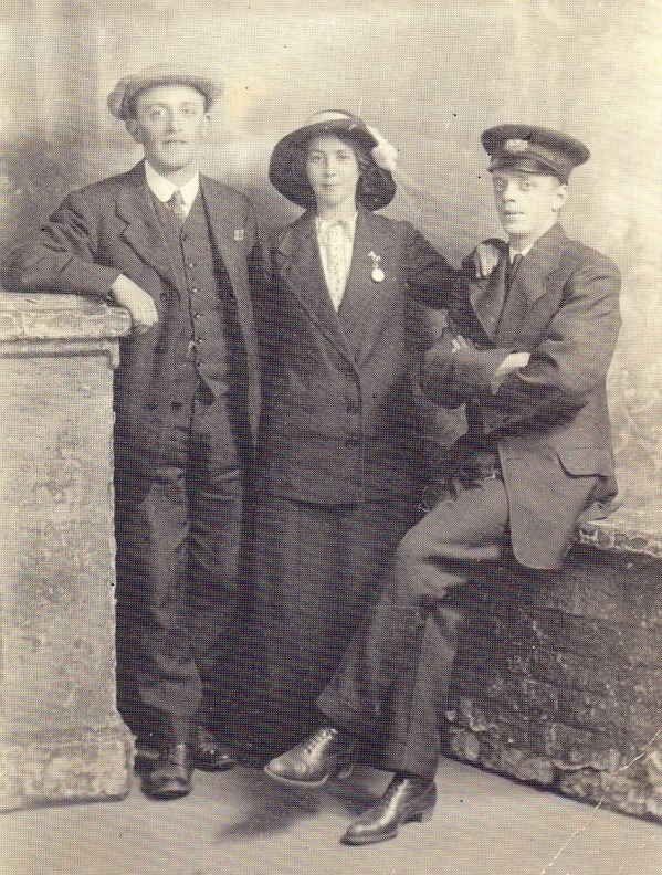 David Brown (seated on the wall), with his sister Alice and her husband-to-be John (Jack) Atkinson. Alice and Jack did not marry until 1919, this photo is c. 1914. Jack also served in the Loyals – he is standing on the left in this photo, thought to have been taken on the Somme in 1916.