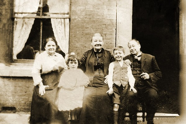 David Brown as a young boy, with family members, c. 1900.