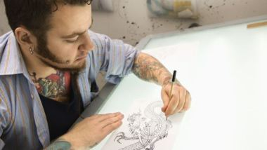 Tattoo Artist Designing a Tattoo