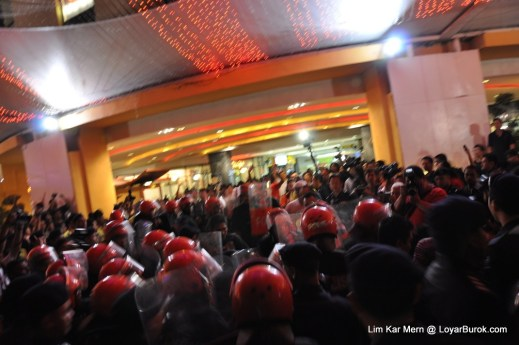 FRU charging into the gathering and forcing them inside the mall.