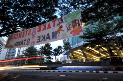 A banner hanging across KLCC convention center during 7th RSPO, Nov 2009, calls for more sustainable practices in Palm Oil industry. (Photo by ChowPong)
