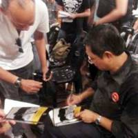 Nizar at PASOC launch signing autographs