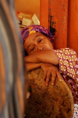 A woman dreaming about travelling in a market in Yogyakarta. | Credit: Ka Ea
