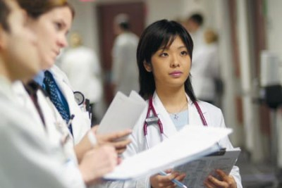 female medical student listens intently