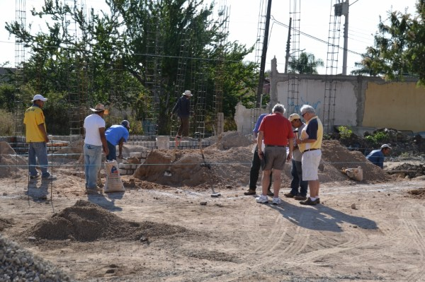 Larry and Ron consult with Lorenzo, our contractor.