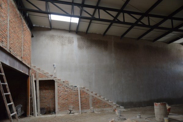 """There's now another stairway to the """"grand hall"""" upstairs. This is in the sanctuary. Note the storage underneath -- or perhaps the area for the soundboard. And the wall behind has been plastered."""