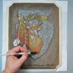 how to paint a wood carving