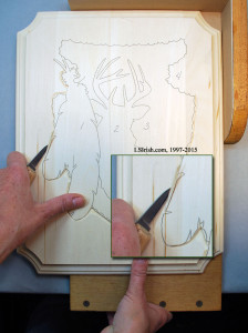 The two strokes of a stop cut in relief wood carving