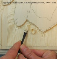 Straight chisel work for smoothing a wood carving