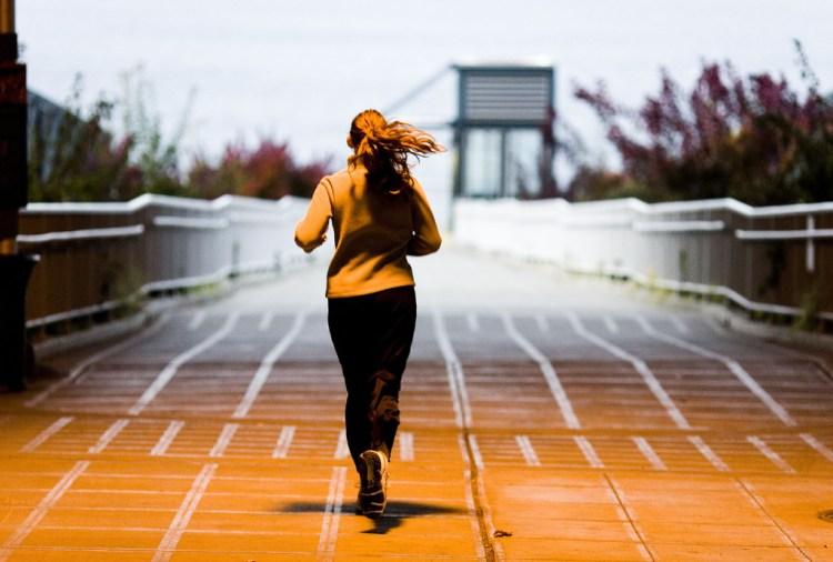 Photo: Thomas Hawk. A woman running on a trail.