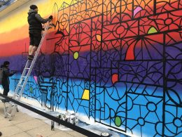 Lincoln Mural being completed in High Street