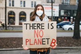 """Protester with a sign that reads """"There is no Planet B"""" at a rally against climate change"""