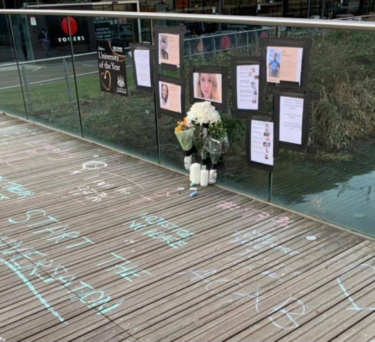 Sarah Everard memorial on University of Lincoln Library Bridge, surrounded by statistics of violence against women.