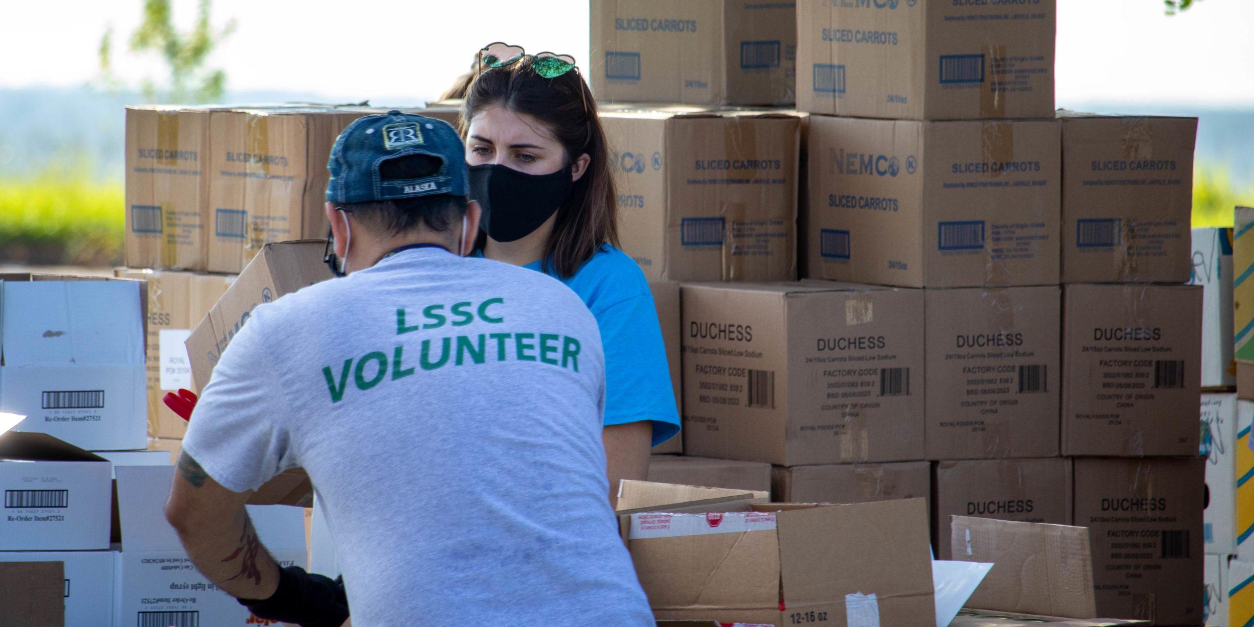 LSSC volunteers package food