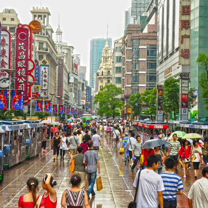 Nanjing East Road in Shanghai at daytime full of people and store signs