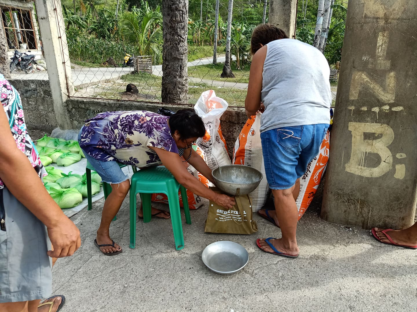 Weighing the rice for distribution.
