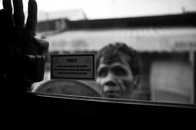 A blind begger stop us while waiting for the ferry on the Mekong River. Vietnam. 2007