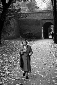 This image somehow reminds me of life fading away. The old woman walking among fallen leaves. Turin. Italy. 2005
