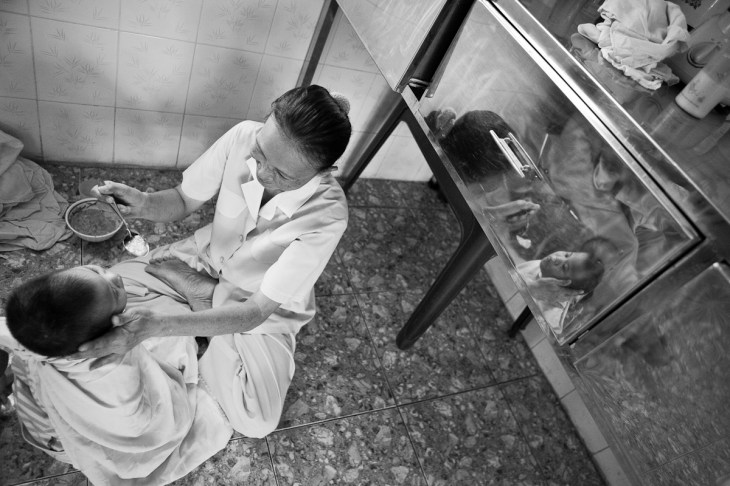 Feeding time for a handicapped orphan at the GoVap Orphanage. Ho Chi Minh City. Vietnam. 2007