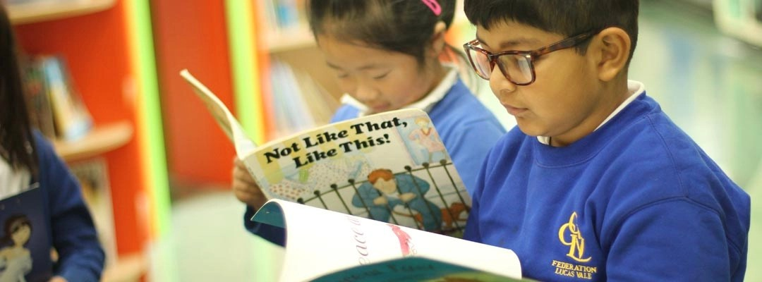 Children from different ethnic backgrounds reading in the library
