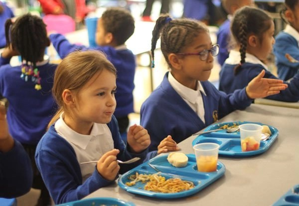 Children enjoying their school lunches