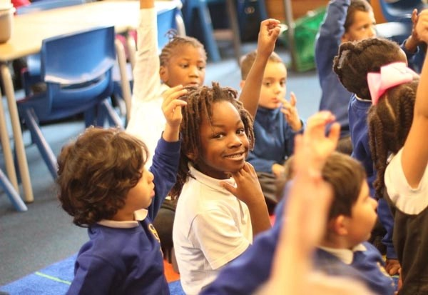 A class working in the safety of the school classroom