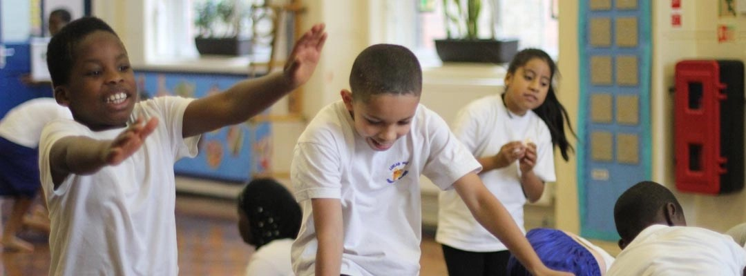 Children warming up during a PE lesson