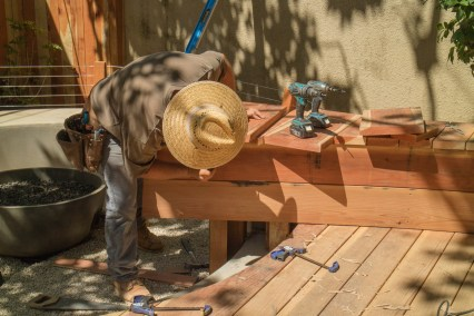 A level, a drill, screwdriver, clamps, saws and other tools all take turns in the construction process
