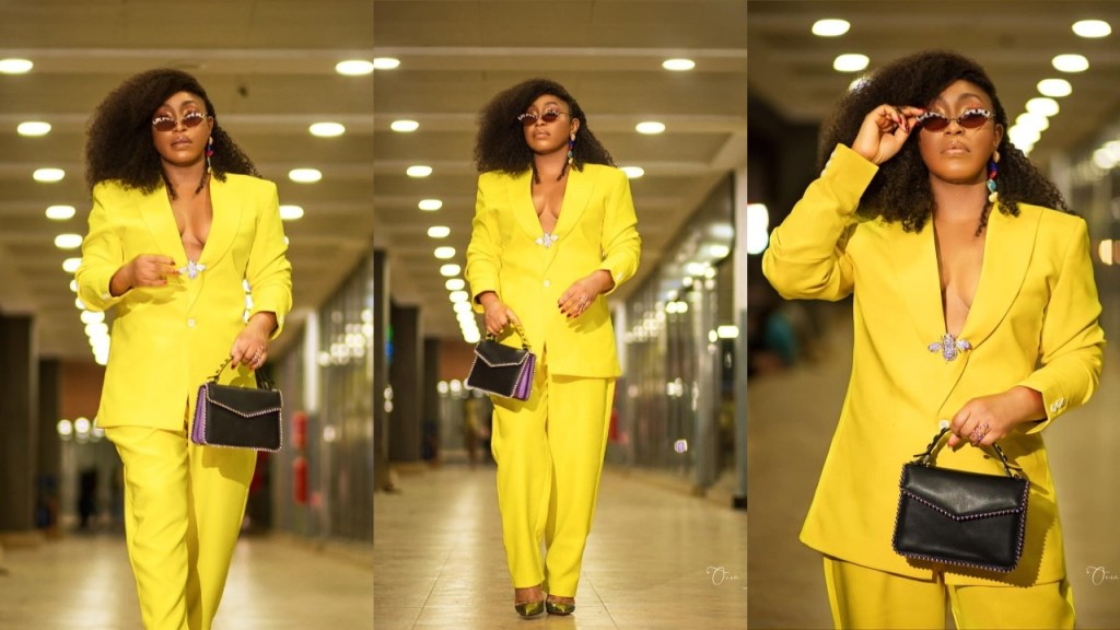 Rita Dominic flashes her Cleavage in a yellow 2-piece Pant Suit (Photos)