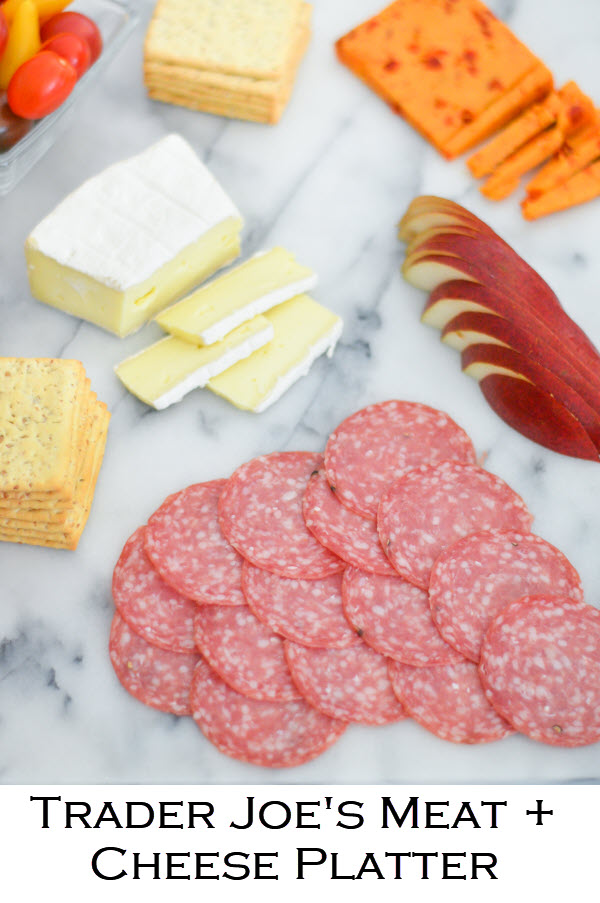 Cheap + Easy Trader Joe's meat + cheese platter. A great last minute Charcuterie appetizer board to serve with wine or sangria. #charcuterie #meatplate #cheeseplate #traderjoes #appetizer #lmrecipes #meatplate #cheeseplate