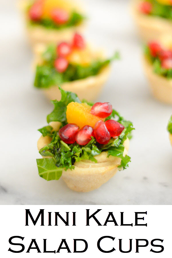 Mini Kale Salad Cups - Bite Size Thanksgiving Appetizers. A delicious kale salad recipe with pomegranate seeds and orange segments, this mix is great for any holiday meal. Place salad bits in homemade mini tart crusts for festive bite size appetizers. #LMrecipes #salad #thanksgiving #friendsgiving #kale #pomegranate #bitesize #holidays #christmas #appetizers #partyfood